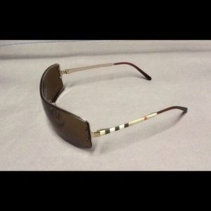8b67ee344599 Burberry Accessories - Burberry polarized sunglasses with Burberry case.